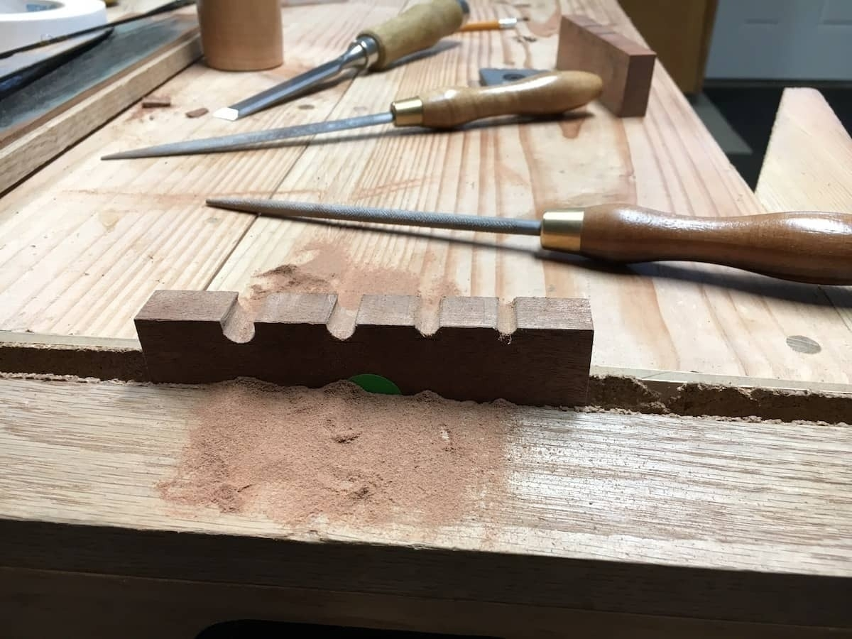 filing out the rod holding grooves