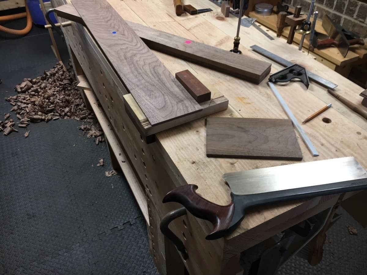 Cutting boards to length with crosscut carcass saw.