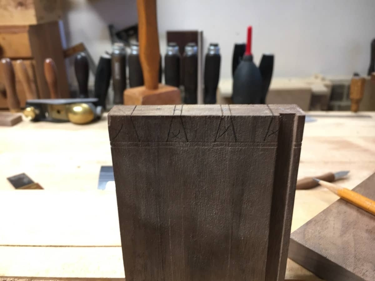 End panel with pencil marks for dovetail cuts